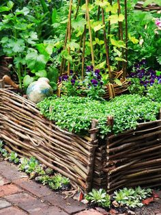 Woven Wicker Gives a Rustic English Garden Appearance There are a variety of materials that can be used to build a raised garden bed, such as woven wicker, giving a rustic English garden appearance.