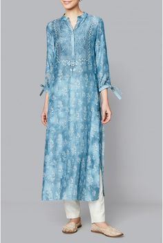 Subtle hues of summer merge with flowers and birds in this powder blue muslin kurta. The printed Mahita kurta with tie up sleeves and a mandarin collar will be your new favourite this summer. Style Tip: Pair this with white straight trousers with our elemental blue earrings. Fabric 40s Muslin Production time: We require 4 weeks to dispatch this outfit