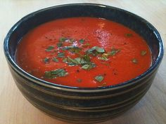 Simple Tomato Soup Recipe Soups with extra-virgin olive oil, yellow onion, garlic, crushed red pepper flakes, crushed tomatoes, fresh basil leaves, coarse salt, water, ground black pepper, sweetener, fresh basil, extra-virgin olive oil