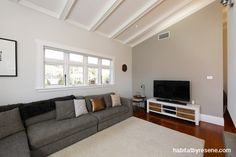 Instead of all white, the walls in the living area are painted in Resene Double White Pointer and a feature wall in Resene Half Napa – a muted ochre, green and grey blend. http://www.habitatbyresene.co.nz/blayne-talents-winning-home