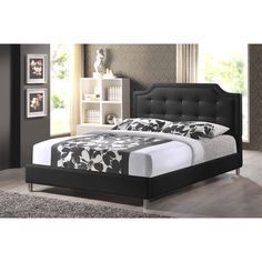 Clean, crisp, and contemporary is the Carlotta Designer Bed frame. Soft black faux leather outfits a scallop-cornered headboard with matching upholstered side rails and low footboard, making this a sleek style for sleeping.