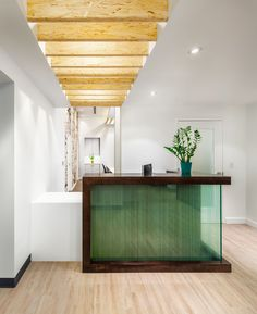 I like the use of wood beams on ceiling idea for front office and nurse station on the side
