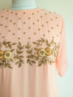Get Set Pretty in this pastel Blush Shaded Handwork Tunic. The tunic features a . Embroidery Suits Punjabi, Zardosi Embroidery, Embroidery On Kurtis, Kurti Embroidery Design, Hand Embroidery Dress, Embroidery Neck Designs, Embroidery Fashion, Embroidery Fabric, Kurti Designs Party Wear