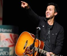 Luke Bryan. Because we WILL be married.. even if it's only in my dreams and don't tell my husband lol