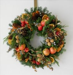 Christmas / harvest wreath - fruits, nuts, pods, pinecones, designed by Sandy Yorks Christmas Door Wreaths, Christmas Flowers, Christmas Crafts, Wreaths And Garlands, Holiday Wreaths, Williamsburg Christmas, Corona Floral, Xmas Decorations, Flower Arrangements