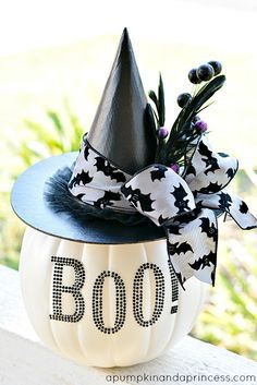 Black and White Glam Pumpkin Supplies: Americana Multi-Surface Paint (in Black Tie) White faux pumpkin from Michaels Boo! rhinestones letters (Recollections brand) paper mache hat hot glue Embellishments: -ribbon -feather with glitter picks