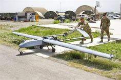 U.S. Army Spc. Jefferic S. Brinkley, left, and U.S. Army Spc. Nathan C. Phillips move an AAI RQ-7 Shadow to the pneumatic launcher before takeoff on Forward Operating Base Salerno, Khowst province, Afghanistan, Aug. 27, 2013. Brinkley and Phillips, unmanned aircraft system repairers, are assigned to the 101st Airborne Division's 4th Brigade Special Troops Battalion, 4th Brigade Combat Team.