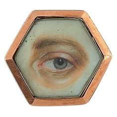 """Lover's Eye, hexagonal brooch, gold-filled, glass, miniature painting of a left grey eye, 1.25""""w x 1 1/8""""h. Sold For $2,000"""