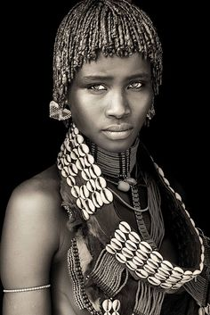 Ethiopia - The striking hamar girl with the chestnut eyes.  Photo Mario Gerth