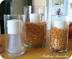 Awesome Vase Filler Tip --- you can vary the size of plastic cup....ideas: candycorn for fall, jellybeans for Easter, seashells for summer, peppermint candies for Christmas etc. Endless possibilities :)