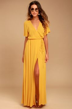 We're forever grateful we found the Much Obliged Golden Yellow Wrap Maxi Dress! Gauzy woven rayon drapes into a sultry surplice bodice, and tying wrap maxi skirt.