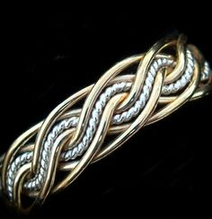 In rose and white gold - a pair of rings with inverse patterns. - ~$575