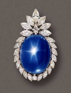 """This Large Star Sapphire has no apparent Name. It appeared at Sotheby's Auction House in April of 2002. Here is what they had to say about it:  """"Star Sapphire and Diamond Pendant-Brooch, Circa 1955. The large Oval-shaped Star Sapphire Cabochon weighs  approx. 145.00cts. within a frame set with 23 Marquise-shaped, 1 Round and 1 kite-shaped Diamond weighing a total of approx. 23.00cts. mounted in Platinum, with Pendant Hook."""" The piece had an Estimate of 30,000 to 40,000 USD"""
