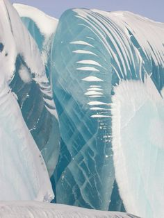 Although the waves appear as if they've been instantly frozen as they broke from the ocean surface, they're actually a natural phenomenon of blue ice, according to a report by the Daily Mail. As outer layers of ice melt during the summer months, new layers of ice compress to form the top of the waves. (Photo by Tony Travouillon)