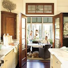 plank walls, stained wood trim, soft cabinet color