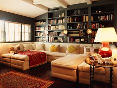 Love the idea of having shelves behind the sectional. Perfect for a family/living room area.
