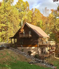 NEW OWNERS! Full log, secluded yet close to everything! Sleeps 15 (11 Adults). - Pigeon Forge Living Room With Fireplace, Gas Fireplace, Outside Fire Pits, Cleaning Faucets, Porch Veranda, Smoky Mountains Cabins, Pigeon Forge, Exterior Lighting, Rental Property