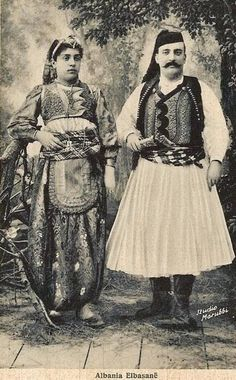 A couple in festive/ceremonial costumes. From Elbasan (Central Albania), early 20th century.