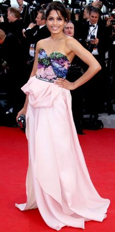 Look of the Day › May 17, 2012 WHAT SHE WORE For the Cannes Film Festival premiere of Moonrise Kingdom, Freida Pinto paired her sequin Michael Angel column with Chopard emerald earrings, the label's tourmaline cocktail ring and a lizard minaudiere from Louis Vuitton. WHY WE LOVE IT From her bright drop earrings to her embroidered clutch, the actress showed attention to detail in a colorful, embellished ensemble.