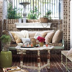 Brick Porch | An extra-large bed swing invites lounging on this porch. Vintage salvage items add character to the space.