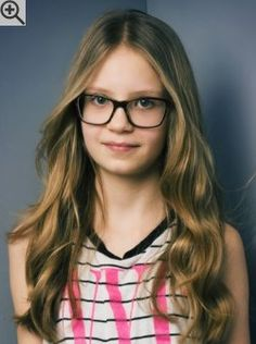 Long hairstyle with curled ends for teenage girls with glasses. A center part keeps the face clear.