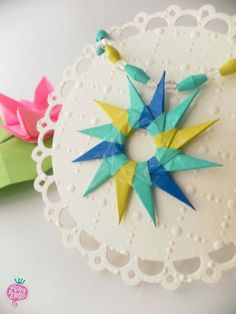 #Paper #bijoux made with #origami technique. Find more on www.rava-nello.it #paperjewellery