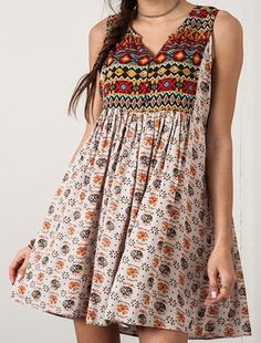 Sleeveless boho sundress with a notched neckline, allover print, and high back. Sleeveless Peasant Dress by Umgee USA. Simple Kurti Designs, Kurta Designs Women, Stylish Dress Designs, Stylish Dresses, Blouse Designs, Fashion Dresses, Indian Designer Outfits, Designer Dresses, Style Hippie Chic
