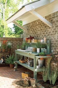 A potting bench with an outdoor sink keeps gardening projects organized.