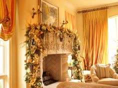 An overabundance or greenery and gold ribbon creates an eye catching and festive mantel display.