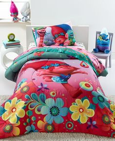 Bring the cheer and charm of Trolls to bedtime with this vibrant four-piece bedding set for a delightful twin bed. | Comforter, sheets and pillow case: polyester | Machine washable | Imported | Set in