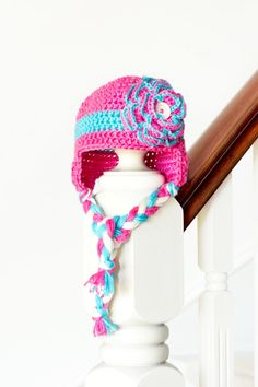 This crochet baby hat is adorable. I love the crochet flower and the stripe! Floral Baby Earflap Hat Crochet Pattern via Hopeful Honey