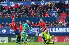 Lionel Messi of FC Barcelona scores his team's second goal during the La Liga match between CA Osasuna and FC Barcelona at Sadar stadium on December 10, 2016 in Pamplona, Spain.