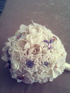 White, cream and purple bouquet with decorations