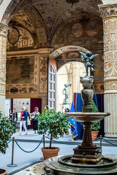 The inner courtyard of the Palazzo Vecchio in Florence, Italy. In the background, in front of the Palazzo, the statue of Perseus is seen in the Loggia dei Lanzi.