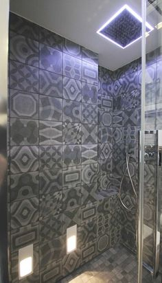 This home renovation project takes place in Rome and focuses on home design with the extraordinary Cerim tiles - Memory of Cerim.   #bathroom #design #rural #chic #new #geometrics #patchwork #concrete #effect #grey #dark #mystic #ceramic #tiles #floor #shower #wall #deco #idea