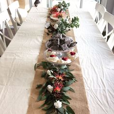 An Australian table runner made from native plants and flowers. Featuring a cake, plums, cherries, lamingtons and mini pavlovas on a teared cake stand. Perfect for Australia Day! Xmas Table Decorations, Silver Christmas Decorations, Christmas Table Centerpieces, Christmas Table Settings, Decoration Table, Aussie Christmas, Summer Christmas, Gold Christmas, Simple Christmas