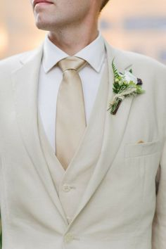 Light gold tie with a cream tux. - For the formal summer wedding at noon.  This way your hubby-to-be doesn't get too hot.