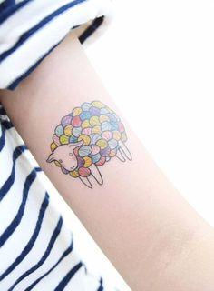 Illustrative style sheep tattoo on the left arm. Tattoo artist:...