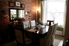 Love the brick wall in the dining room