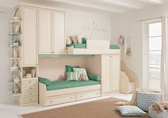 Modern styling and space saving design for two single beds leave plenty of space for play. Creamy white and a fresh green visually enlarge and brighten the bedroom.