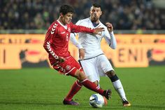 Andrea Petagna (R) of Italy is challenged by Christian Norggaard of Denmark during the International Friendly match between Italy U21 and Denmark U21 at Stadio Atleti Azzurri d'Italia on November 14, 2016 in Bergamo, Italy.