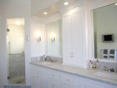 Really liking the idea of double vanity with tall cabinet in between