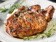Tender, juicy, bone-in glazed pork chops are seared and coated in a lip-smacking maple balsamic vinegar sauce. Perfect for a weeknight dinner, or a party!