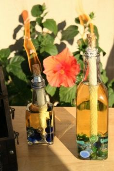 Make Your Own Citronella Oil Candles.  Oil and vinegar jars from the dollar store and decorative stones. I would use something a little better than foil to keep the wick from touching the glass.  You have to be very careful with this project.