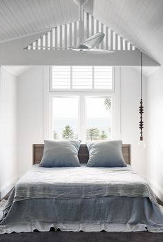 This serene bedroom within a [Palm Beach bungalow](http://www.homestolove.com.au/sandstone-house-restored-to-former-glory-3731) is an excellent example of 'less is more'. *Photo: Nicholas Watt* Dormer Windows, Walk In Robe, Stunning View, Tweed, Beach House, Nursery, Linen Bedding, Curtains, Bedroom