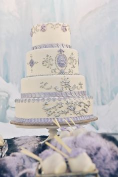 purple and white wedding cake http://trendybride.net/ice-castles-colorado-styled-wedding-shoot/