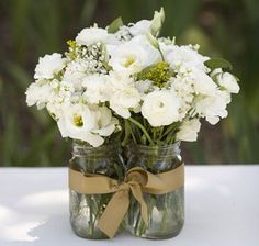 mason jar rustic wedding centerpiece, but maybe with enough for each person at a table to take as a favor? With a table name in the middle. Alicyn%u2019s wedding