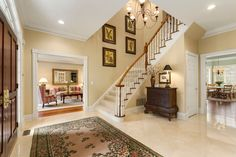 Traditional Entryway with High ceiling, Crown molding, Carpet, limestone tile floors