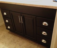 Transform builder oak cabinets into dark cabinets.