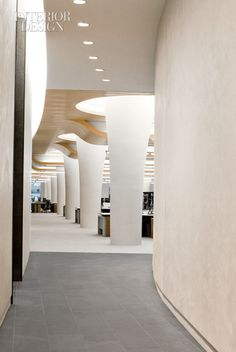 Quietly: Peace Pervades a Chicago Trading Firm by Perkins + Will. Glass-reinforced gypsum enclosures wrap the structural columns in the bull pen. Atrium Design, Column Design, Floor Design, Architectural Columns, Interior Columns, Corporate Interiors, Office Interiors, Commercial Design, Commercial Interiors
